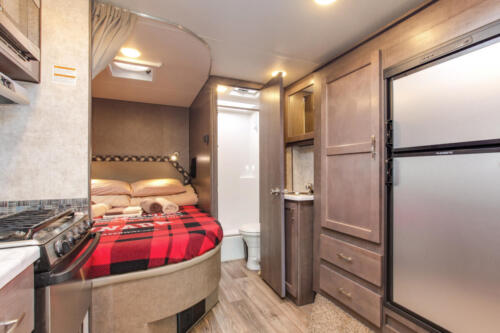 Four Seasons RV Rentals - Class C Large | Kitchen & Rear Bed